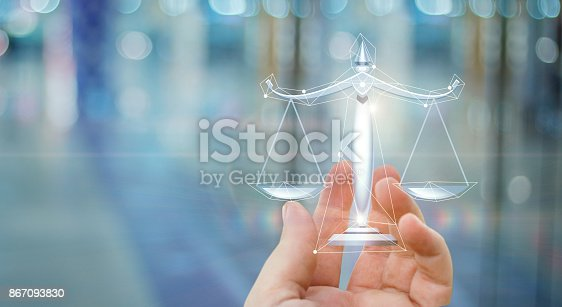 istock Scales of justice in hand . 867093830