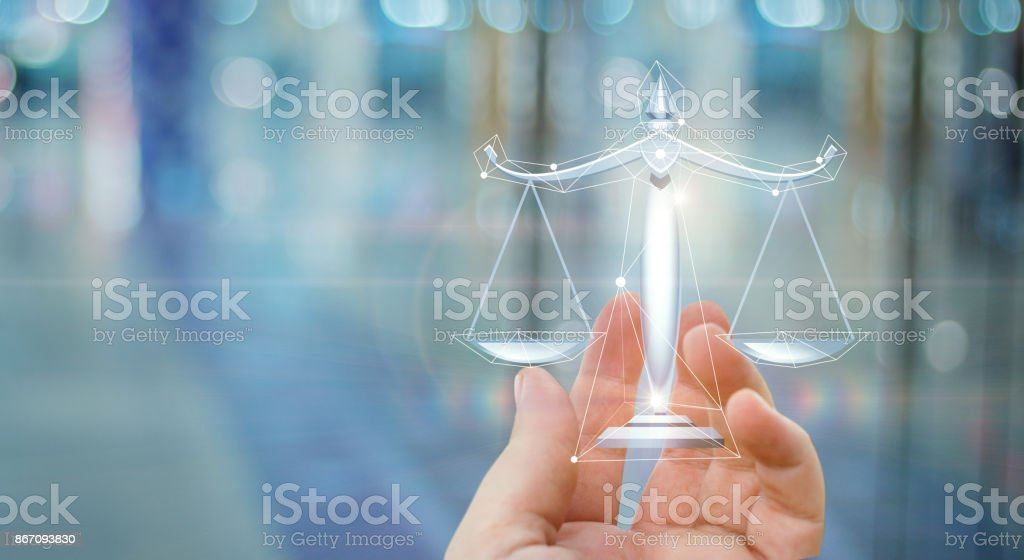 Scales of justice in hand . stock photo