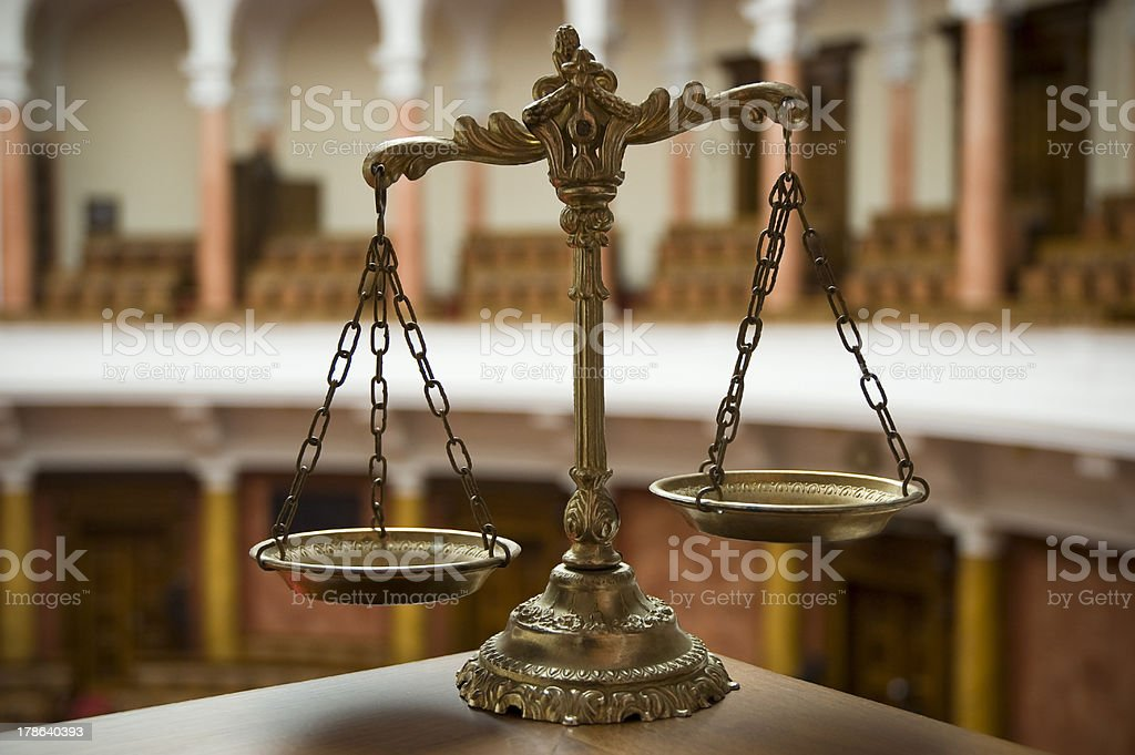 Scales of Justice in the Courtroom royalty-free stock photo