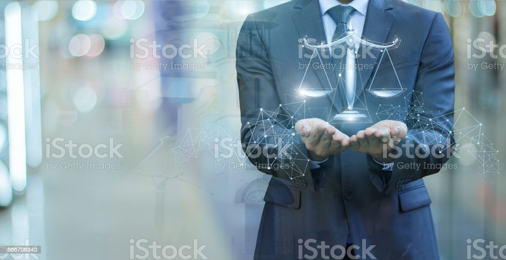Scales of justice in the hands of a lawyer . stock photo