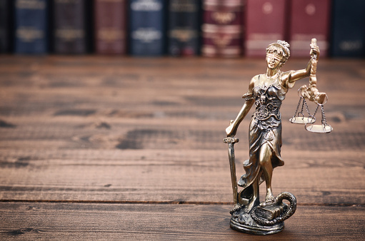 istock Scales of Justice, Justitia, Lady Justice and Law books in the background. 928803184
