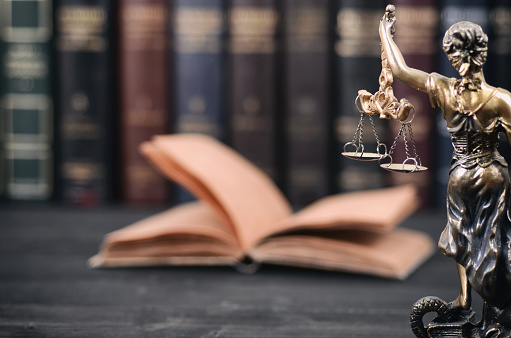 istock Scales of Justice, Justitia, Lady Justice and Law books in the background. 933547178