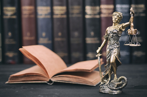 istock Scales of Justice, Justitia, Lady Justice and Law books in the background. 936436730