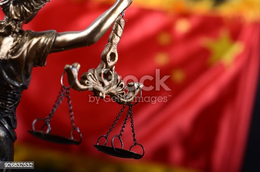 istock Scales of Justice, Justitia, Lady Justice in front of the flag of China in the background. 926832532