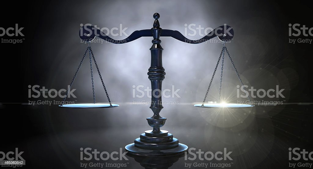 Scales of justice on dark background stock photo