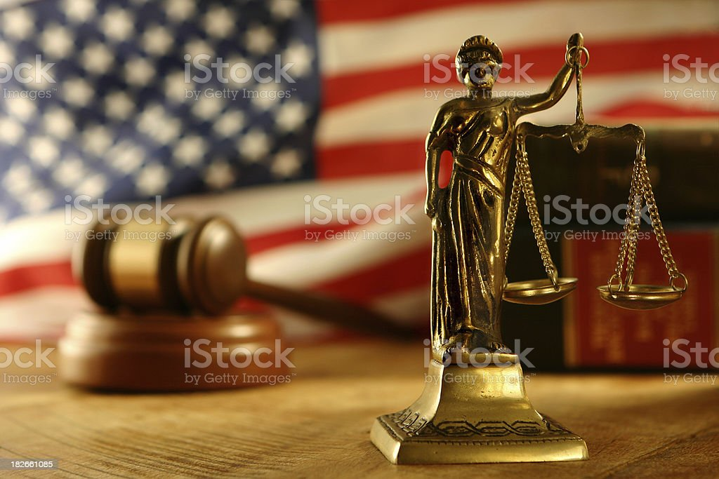 Scales of Justice Scales of Justice, US Flag, gavel and law books.  Focus on Scales of Justice. American Flag Stock Photo