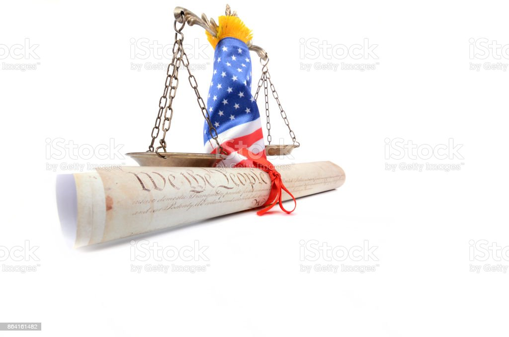 Scales of justice rolled up with  American flag . royalty-free stock photo