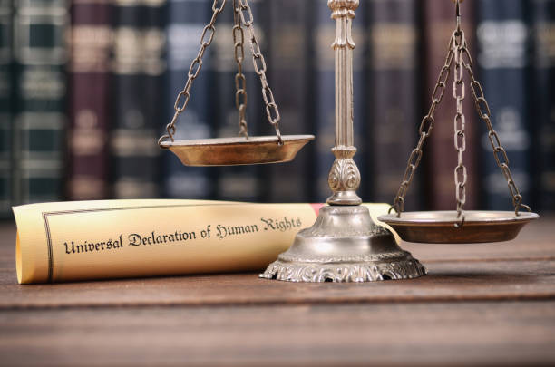 Scales of Justice, Universal declaration of human rights on a wooden background, human rights concept. Law and Justice, Scales of Justice, Universal declaration of human rights on a wooden background, human rights concept. human rights stock pictures, royalty-free photos & images