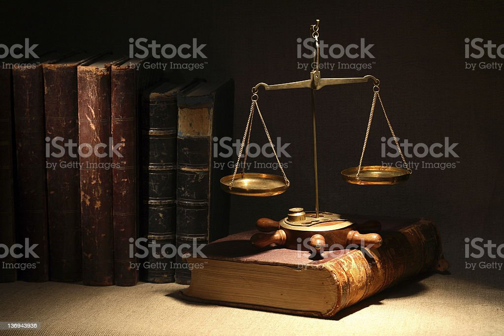 Scales of justice with antique law books stock photo