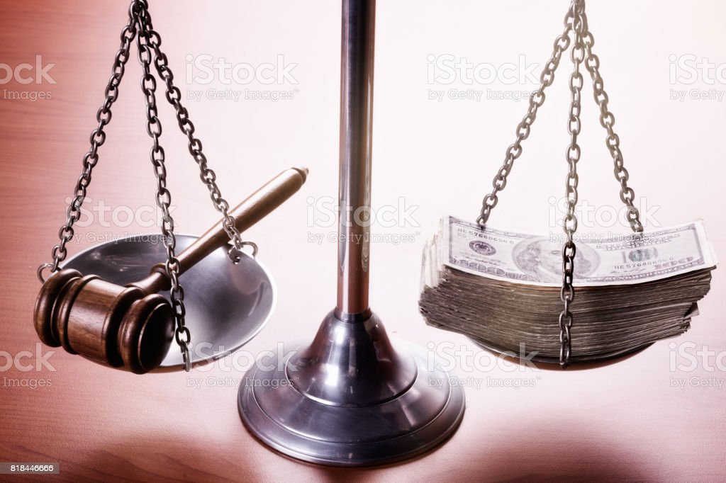 Scales of Justice with wad of money and gavel stock photo