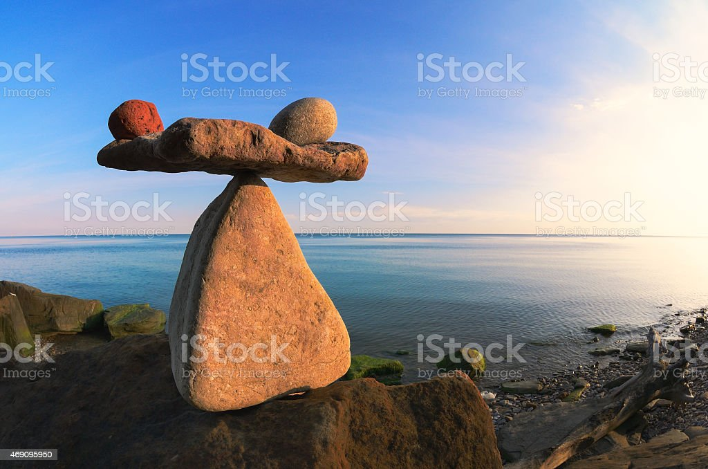 Scales of pebbles on the seashore stock photo