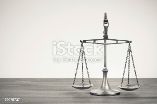 istock Scales on a table. Vintage sepia photo 179075737
