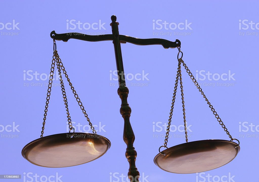 Scales On Plain Blue Background royalty-free stock photo
