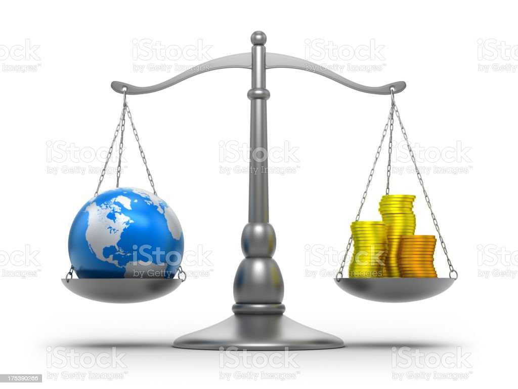 Scales with earth and money - isolated / clipping path royalty-free stock photo