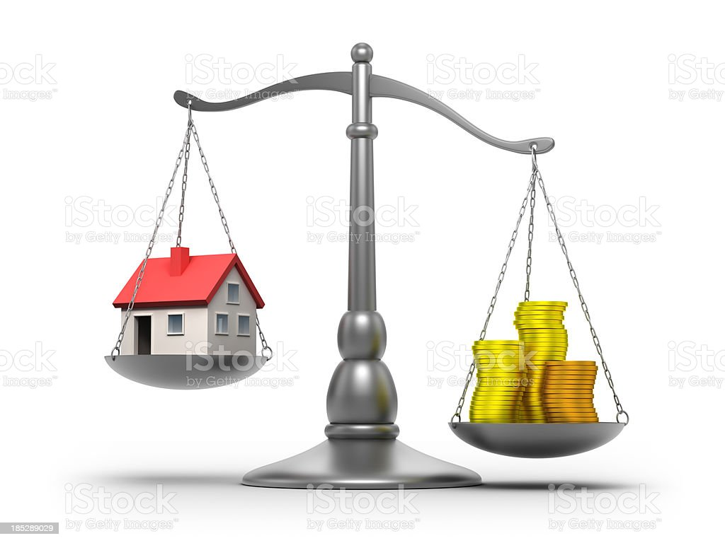 Scales with house and money - isolated / clipping path royalty-free stock photo