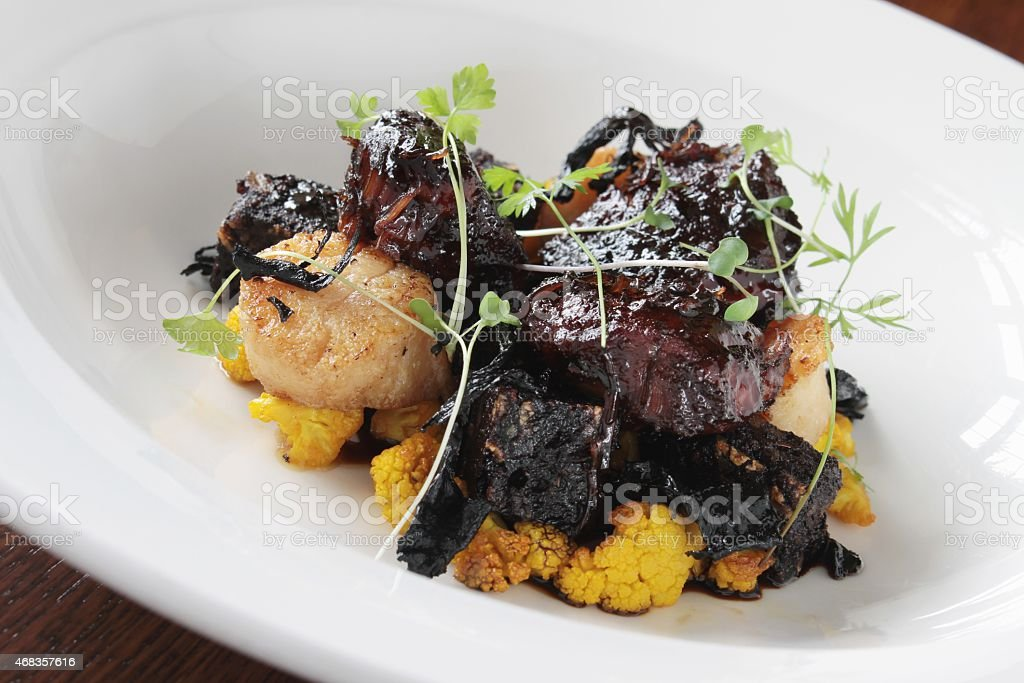scallop and black pudding plated starter royalty-free stock photo