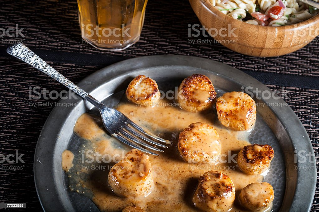Scallops in Fennel Coconut Sauce stock photo