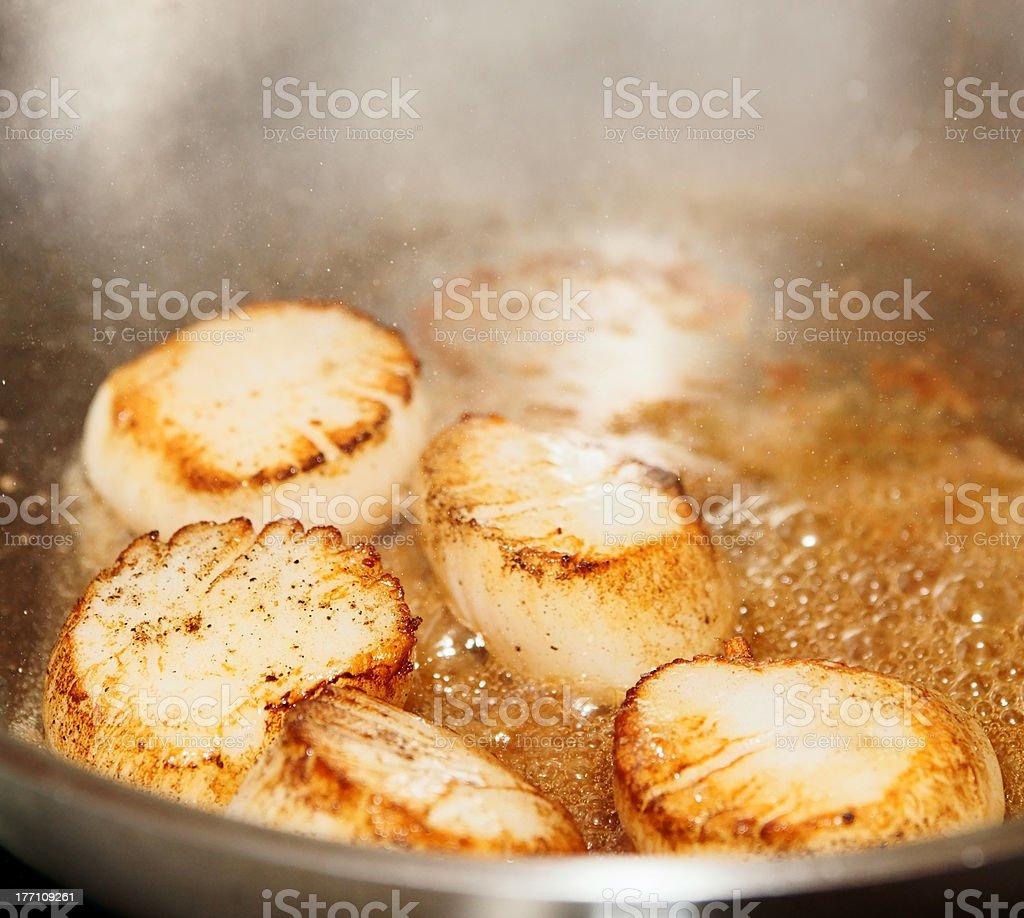 Scallops on hot pan royalty-free stock photo