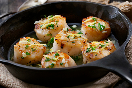 Scallops Poached in a Garlic Butter Sauce with Parsley and Lemon Zest