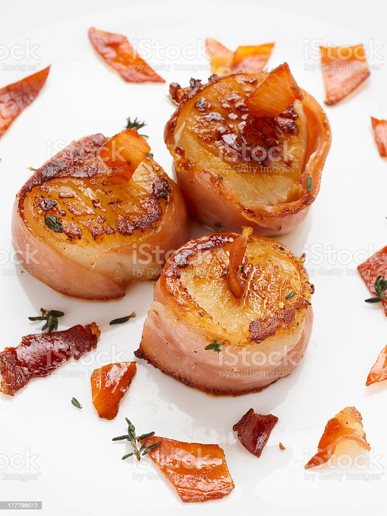 Scallops wrapped in bacon and seared stock photo