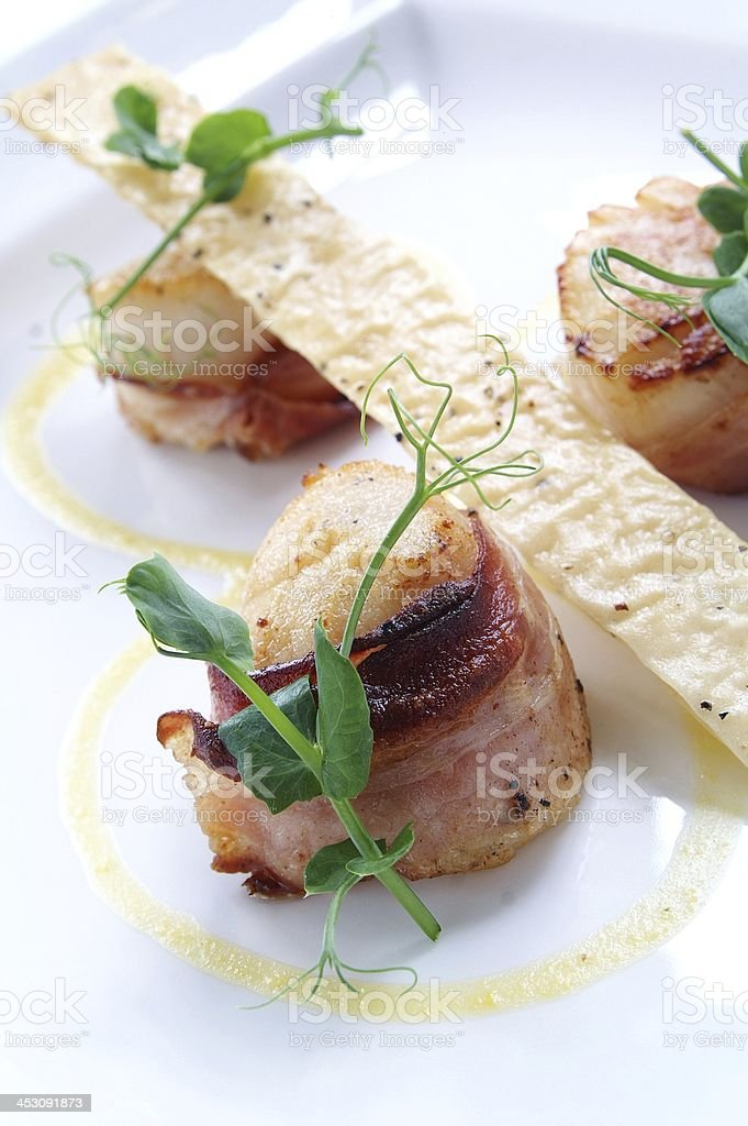 scallops wrapped in pancetta stock photo