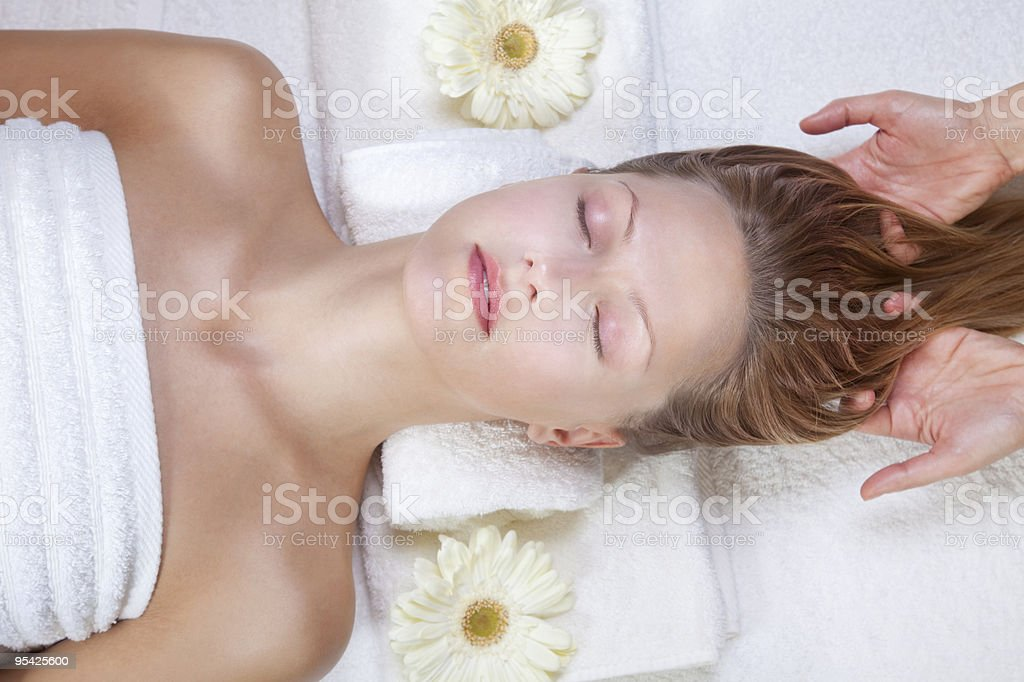 Scalp massage stock photo