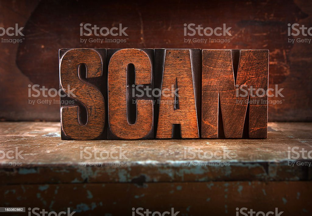 Scam - Letterpress letters royalty-free stock photo