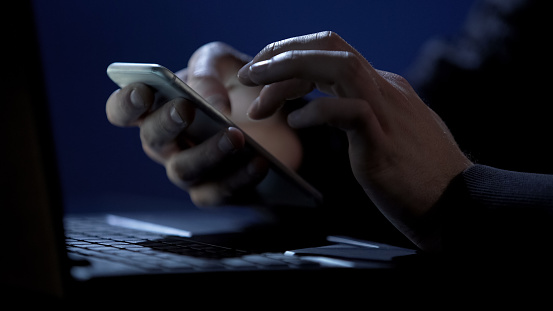Scammer Holds Smartphone Cracks Twofactor Authentication Steals Money Online Stock Photo - Download Image Now