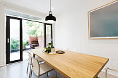 Scandi styled dining room interior with outlook to courtyard