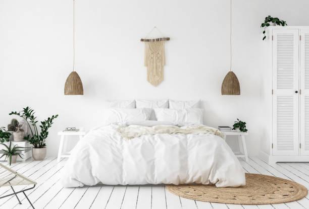 scandi-boho stil schlafzimmer - schlafzimmer stock-fotos und bilder