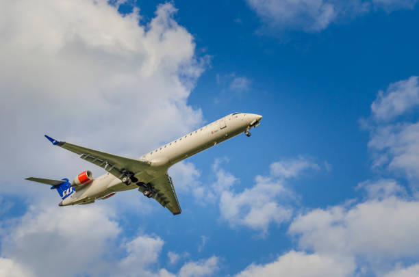 Scandinavian Airlines Bombardier CRJ900 approaching airport stock photo
