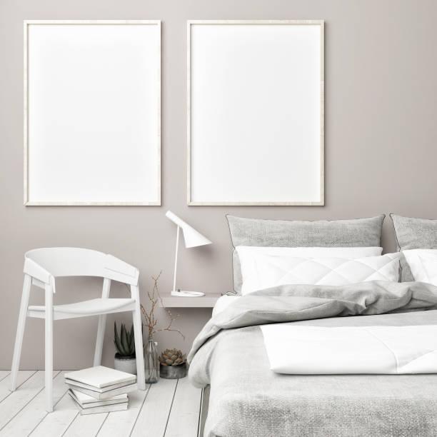 skandinavische schlafzimmer mit mock-up poster - tafel schlafzimmer stock-fotos und bilder