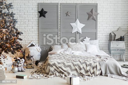 istock scandinavian Christmas interior with bed and tree 892687192