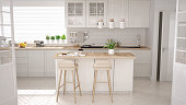 istock Scandinavian classic kitchen with wooden and white details, minimalistic interior design 652904362