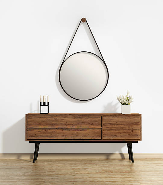 Scandinavian console table with captain's round mirror stock photo
