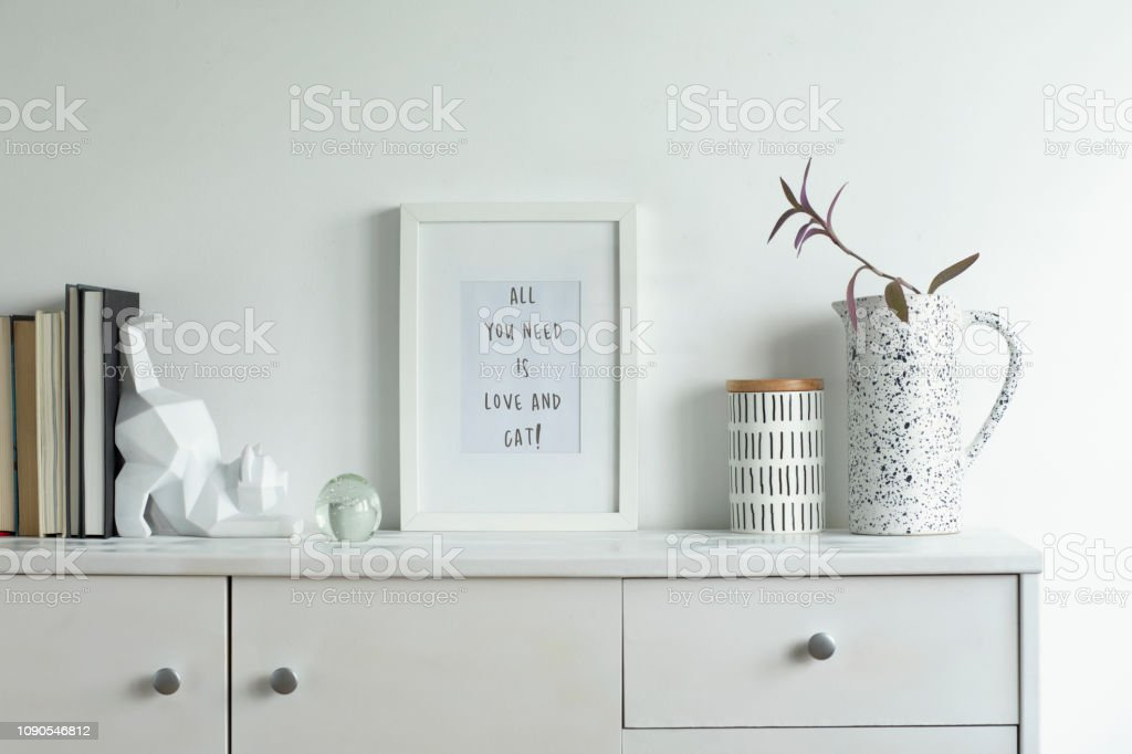 Modern and stylish concept of mock up frame in white interior.