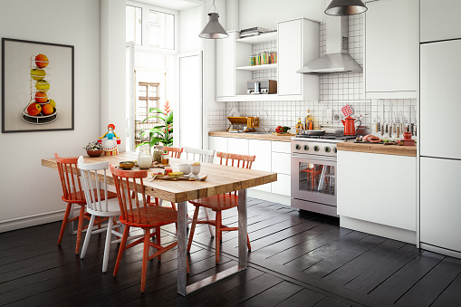 Digitally generated affordable Scandinavian style domestic kitchen interior with a dining table, kitchen counter and lots of props.  The scene was rendered with photorealistic shaders and lighting in Autodesk® 3ds Max 2016 with V-Ray 3.6 with some post-production added.