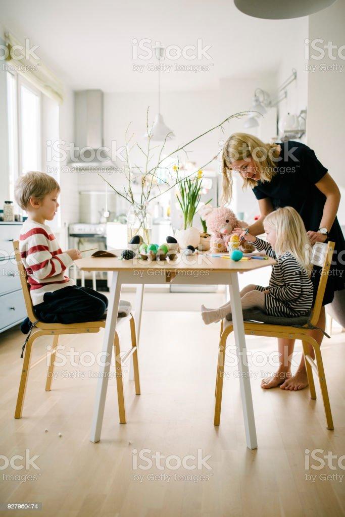 Scandinavian family during Easter preparation stock photo