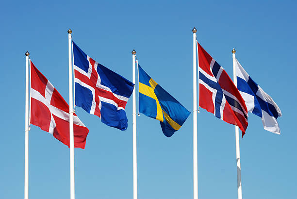 Scandinavian flags Scandinavian flags on a blue sky. scandinavian culture stock pictures, royalty-free photos & images