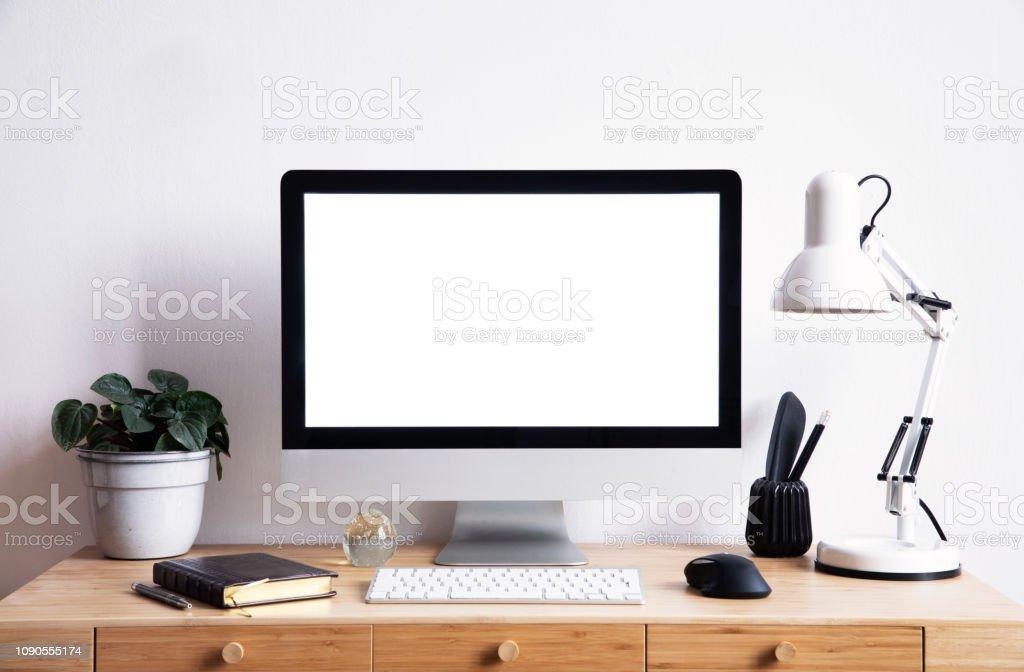 Interior of home creative desk. Mock up computer screen concept.