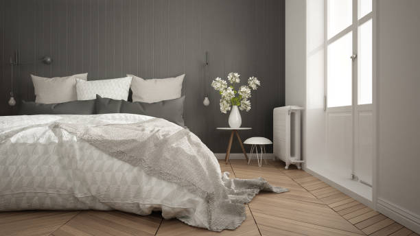 Scandinavian minimalist bedroom with big window and herringbone parquet, white and gray interior design, close-up stock photo
