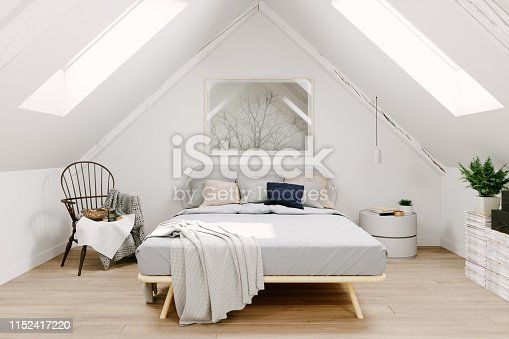 Interior of a Scandinavian style attic bedroom.