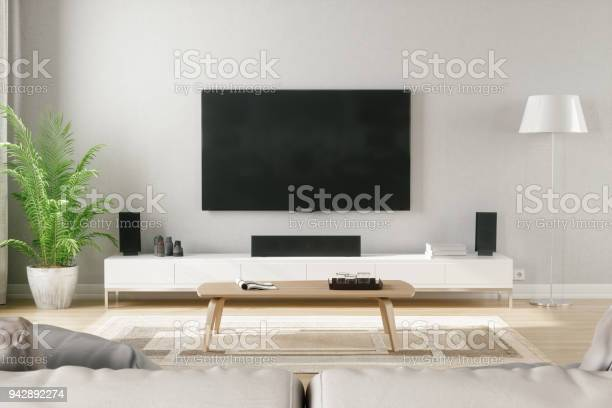 Scandinavian style modern living room with entertainment center picture id942892274?b=1&k=6&m=942892274&s=612x612&h=um6lykfshorj1j658oe86r4sg 2p6bwnmvrw suuhtw=