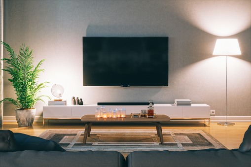 Cozy scandinavian stlye living room with home entertainment center at night.