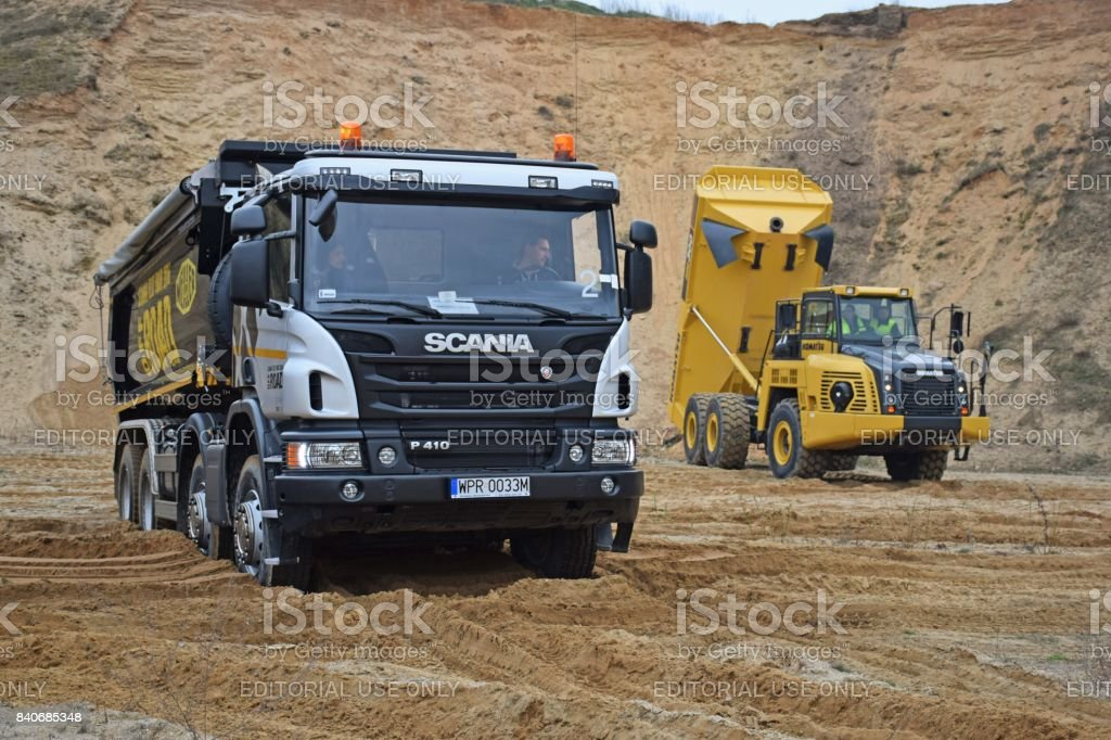 Scania tipper truck and Komatsu loader stock photo