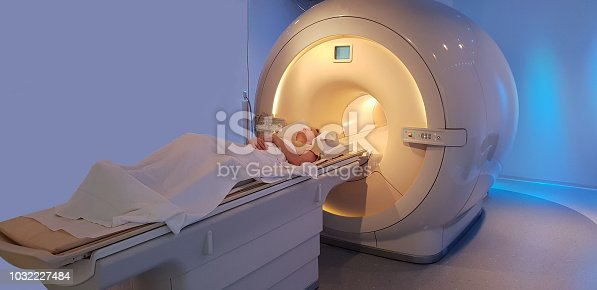 Mature women in the MRI scanner alone.