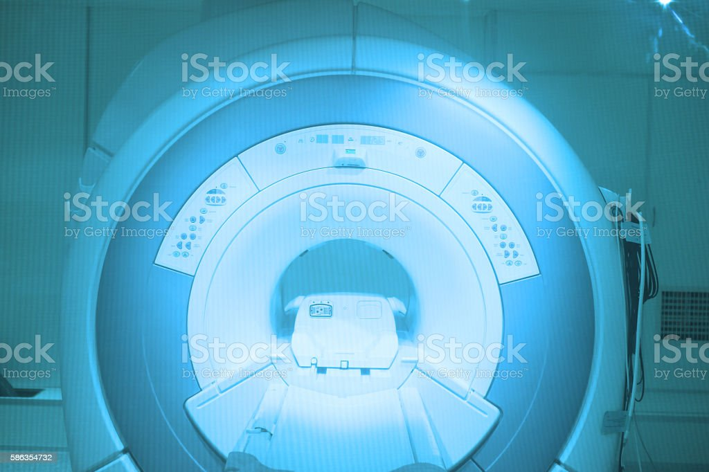 MRI scanner room in hospital stock photo