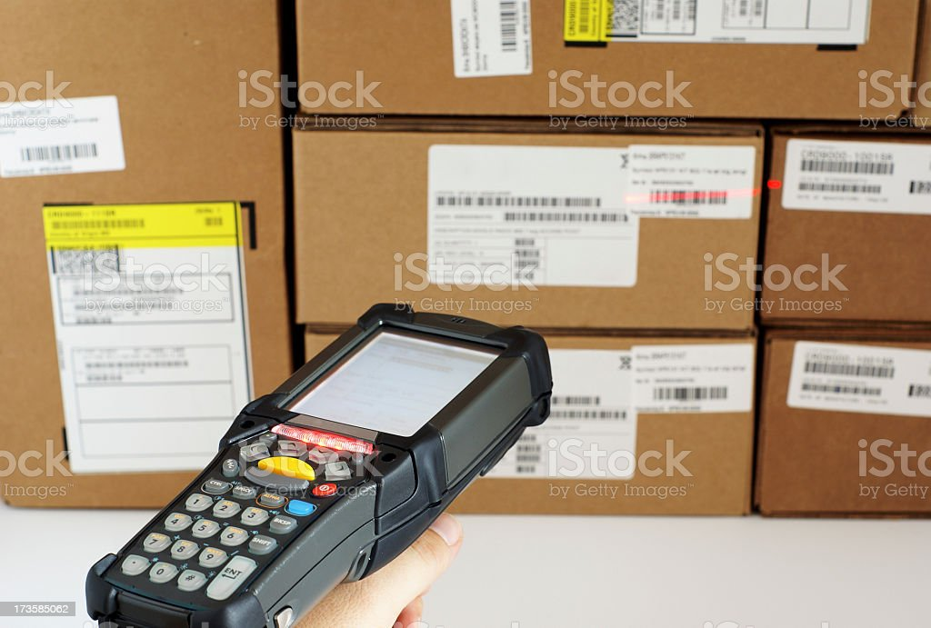 Scanning a bar code with a scanner royalty-free stock photo