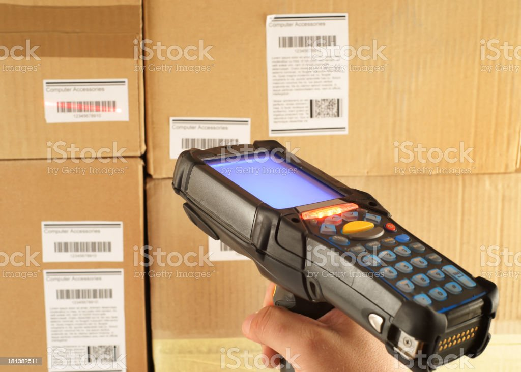 Scanning bar code in warehouse stock photo