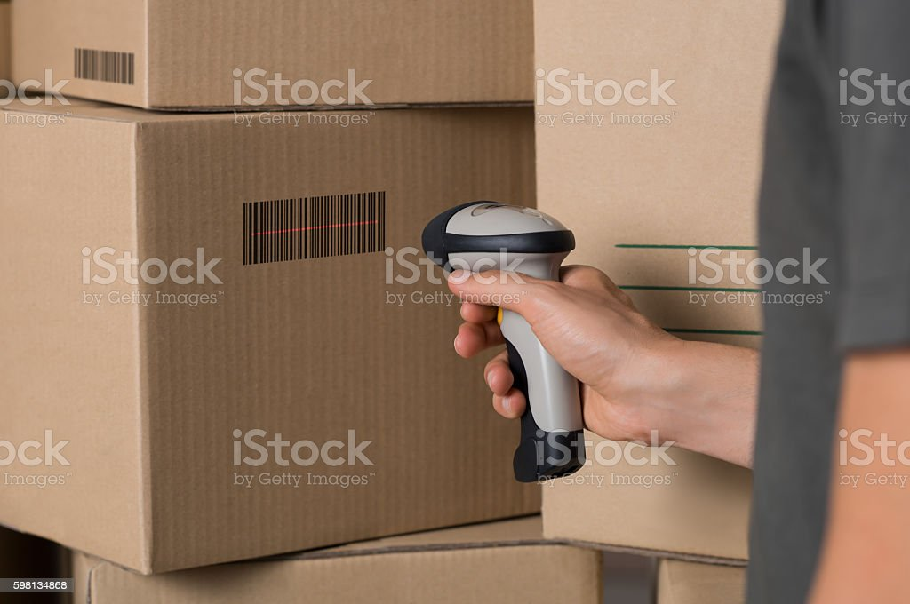 Scanning barcode on box stock photo